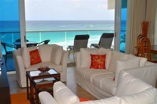 living room and balcony view of condo 401 Ocean One Barbados